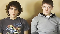 Two young twinks are standing in line and jerking their boners