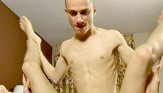 Skinny bald twink boy is holding boyfriend's legs up and pumping up his asshole