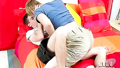 Pretty young gay boys are exciting each other with hot kiss