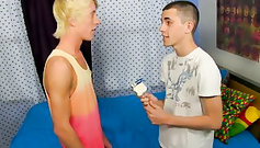 Slender gay with pierced navel is being licked up by his fucker friend