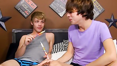 Handsome gay friends are naughtily kissing on the bed