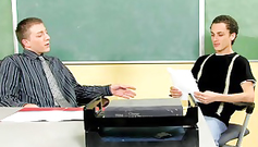 Nude twink student is standing on the desk and fucking his teacher in mouth